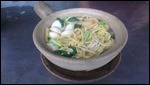 Claypot Noodles with fish balls.
