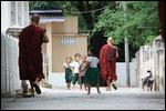 School children begging from the Monks