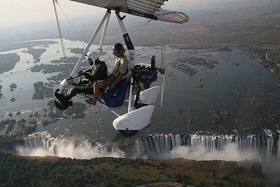 Microlighting over Victoria Falls, Zambia.