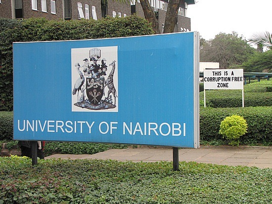 Look at the sign behind the University's sign