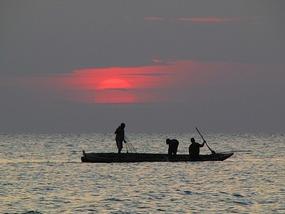 Sun sets off Zanibar, Tanzania.