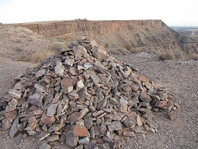 Travellers all add their stone to this pile