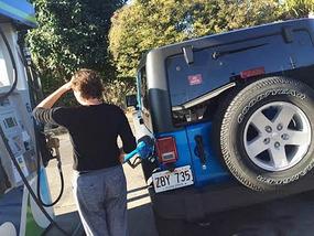 Kara filling Jeep tank with gas - Hawaii