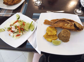 Fried Mojarra, patacon, and Coconut Rice