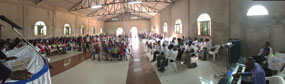 Panoramic view of the church hall and brethren