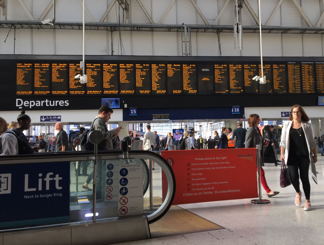 Watching the departure board at Waterloo Station