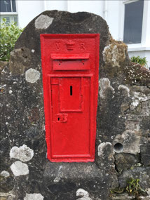 An old post box in a rock