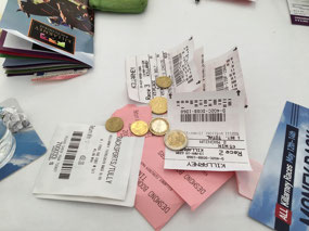 A pile of losing tickets with some winnings on top