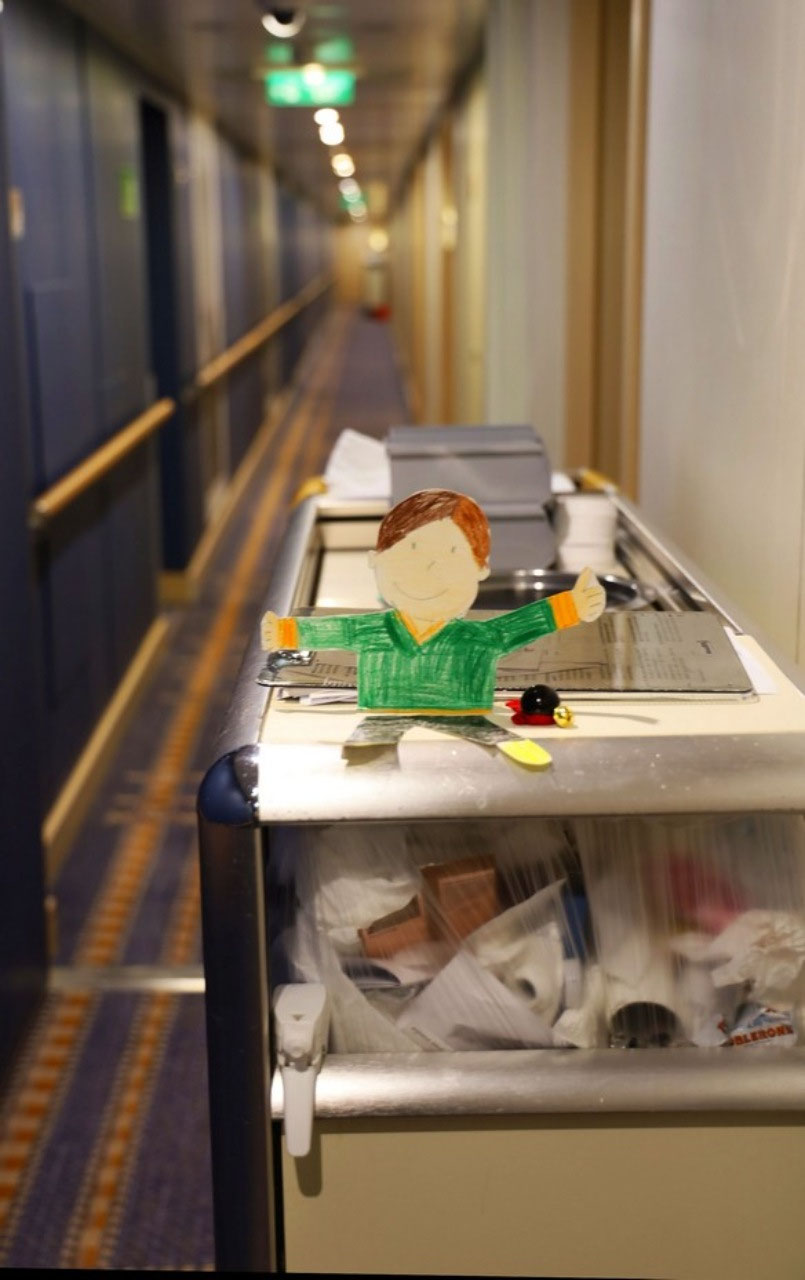 Flat Stanley hitching a ride on a cleaning cart