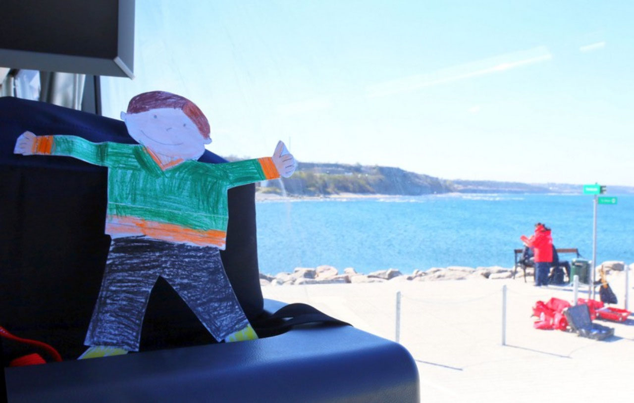 Flat Stanley on the tour bus in Visby