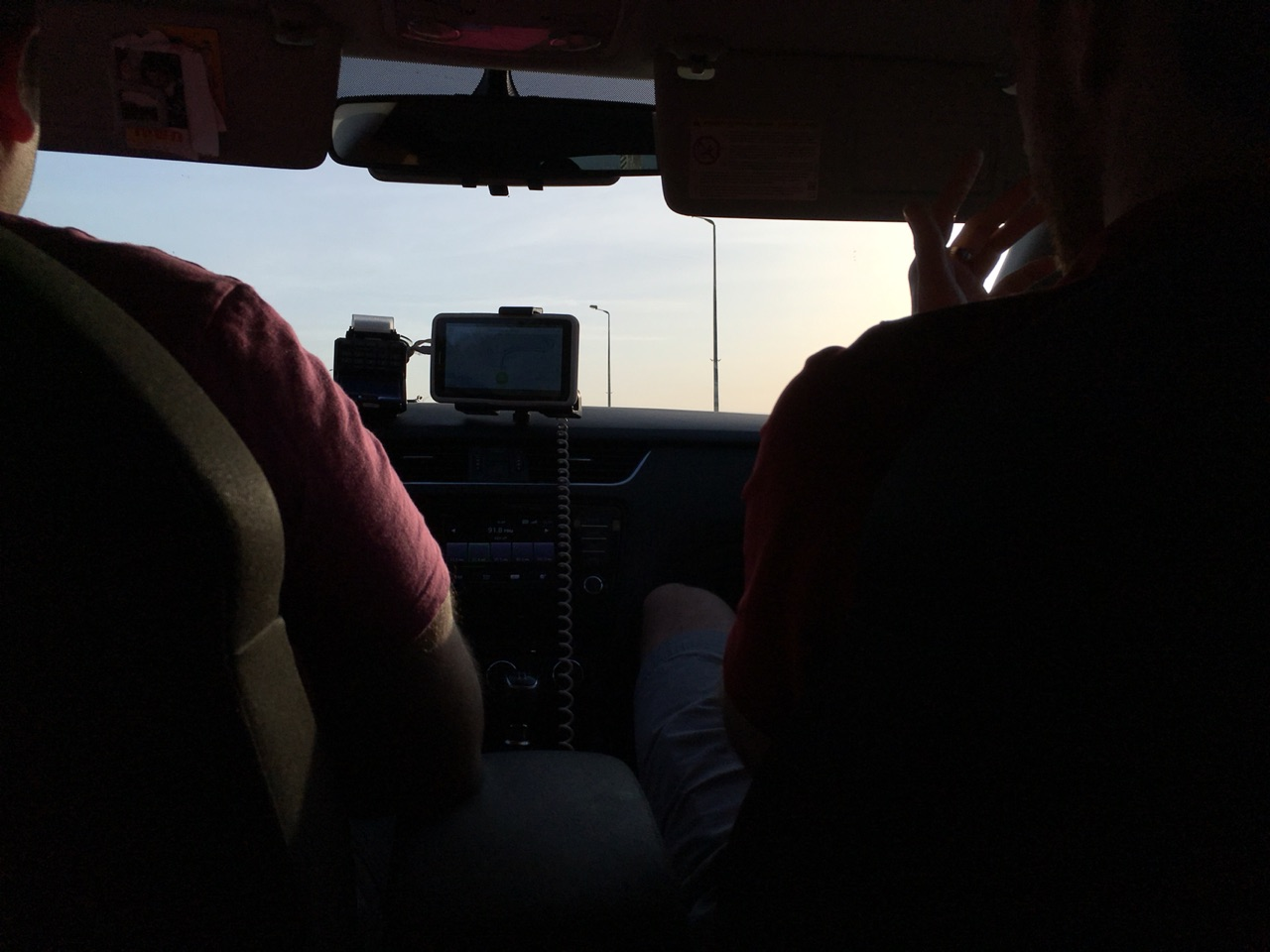 Inside the taxi to the airport to fetch cars to...