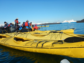 Loading kayaks from the Zodiacs
