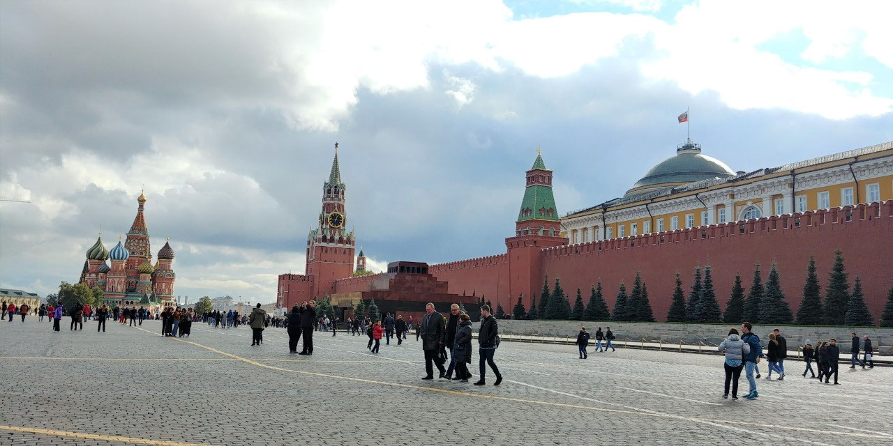Red Square and Kremlin Wall. St. Basil in the dist