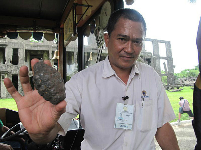 Tour guide shows grenade found