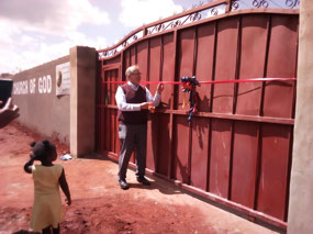 Ribbon cutting at the wall and gate