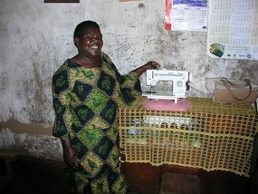 d Jesse Nyelubwe with sewing machine