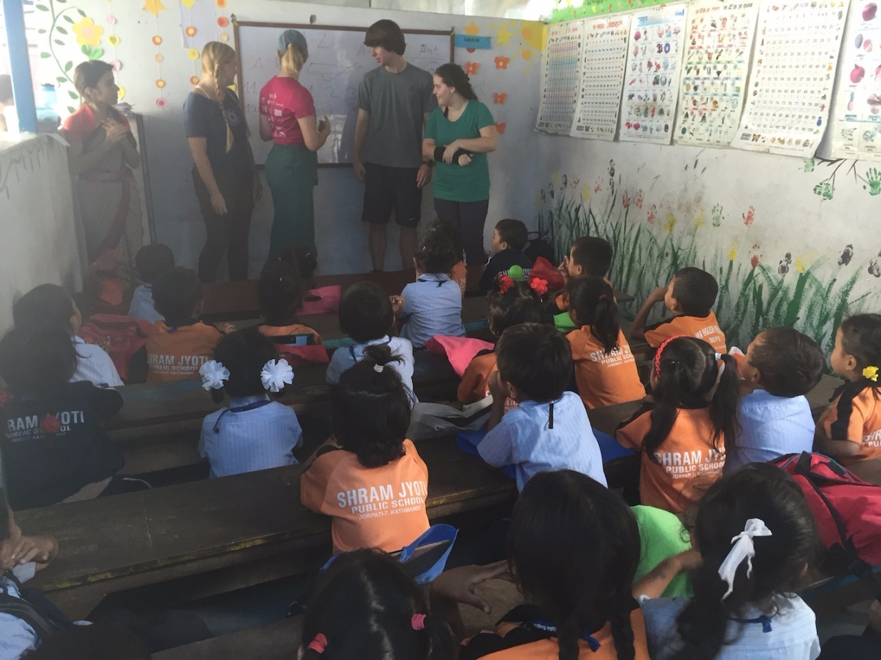 Teaching a class to village children.