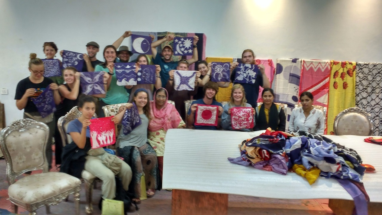 Team posing with completed Batik art masterpieces.
