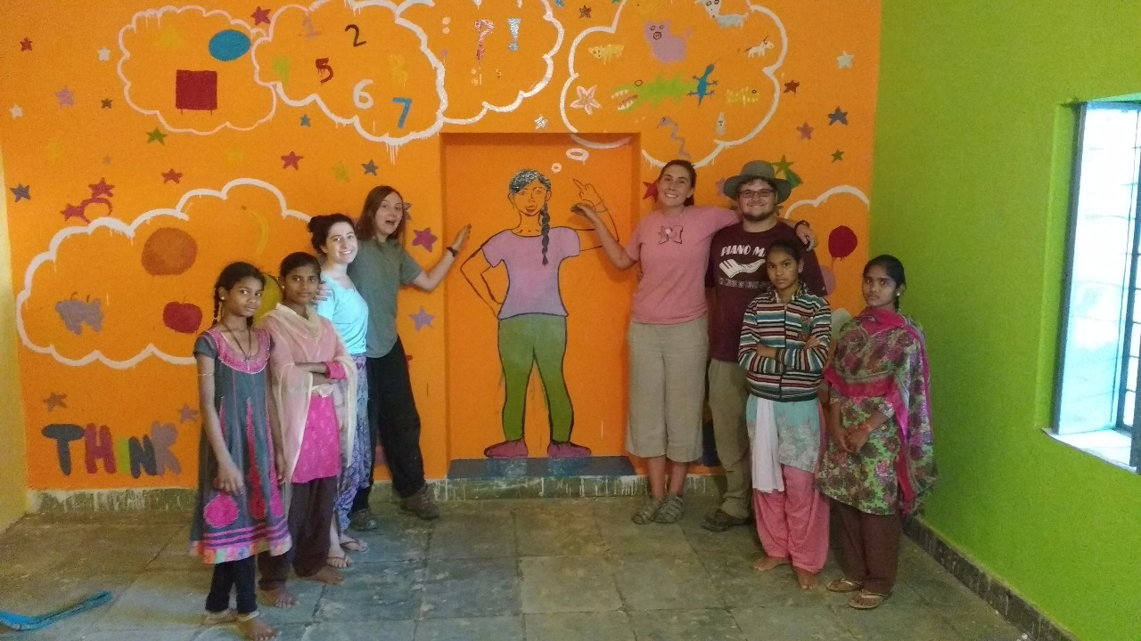 Posing with finished mural.