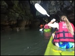 Kayaking through a cave.